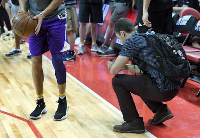 """A photographer takes pictures of <a class=""""link rapid-noclick-resp"""" href=""""/ncaab/players/136151/"""" data-ylk=""""slk:Lonzo Ball"""">Lonzo Ball</a>'s sneakers. This is all part of the plan. (Getty Images)"""