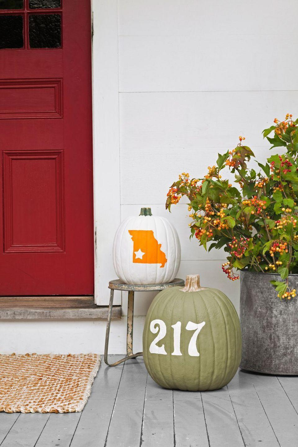 "<p>If you've got tons of hometown pride, then emblazon your state and house number on some pumpkins. First, you'll need <a href=""https://www.amazon.com/Hy-Ko-Prod-MM-4N26-Number-Assortment/dp/B000LNKH8Q/?tag=syn-yahoo-20&ascsubtag=%5Bartid%7C10055.g.4602%5Bsrc%7Cyahoo-us"" rel=""nofollow noopener"" target=""_blank"" data-ylk=""slk:number stickers"" class=""link rapid-noclick-resp"">number stickers</a><em>, </em>as well as a decal in the shape of your state<em>.</em> Use <a href=""https://www.amazon.com/Fiskars-Corporation-Star-Punch-23537097J/dp/B071XGD7YC/?linkCode=ogi&tag=countryliving_auto-append-20&ascsubtag=[artid