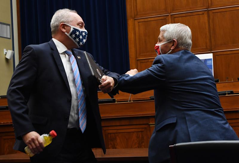 Rep. Steve Scalise (R-La.), left, elbow-bumps Anthony Fauci, director of the National Institute for Allergy and Infectious Diseases, after a House Subcommittee on the Coronavirus Crisis hearing on Capitol Hill in Washington, D.C., on July 31. (Photo: KEVIN DIETSCH via Getty Images)