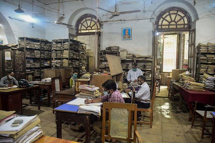 Civil-Servants work at an office of the Uttar Pradesh state government in Allahabad on June 21, 2021 after the state allowed public and private offices to function in full capacity post the lockdown that was imposed earlier to curb the spread of Covid-19 coronavirus