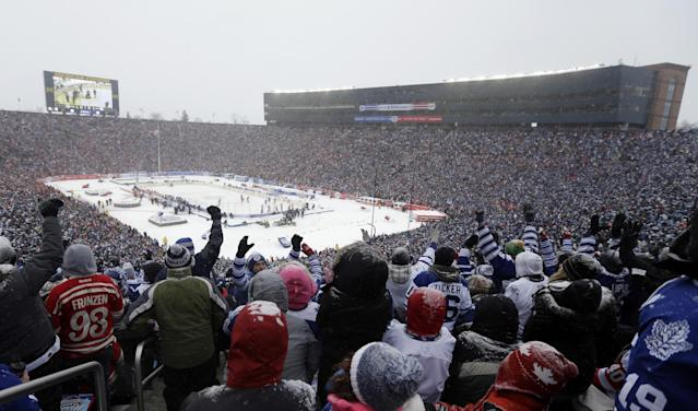 Toronto Maple Leafs fans celebrate a goal by center Tyler Bozak during the third period of the Winter Classic outdoor NHL hockey game against the Detroit Red Wings at Michigan Stadium in Ann Arbor, Mich., Wednesday, Jan. 1, 2014. (AP Photo/Carlos Osorio)