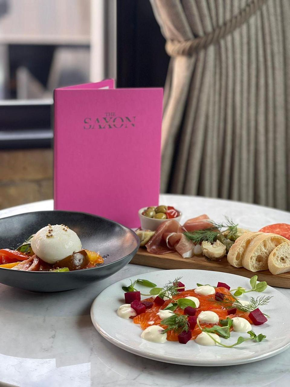 """<p><strong>Happy hour deal:</strong></p><p>The newly opened south London venue offers two for one cocktails from Tuesday - Friday, 4 and 7pm and on the weekend between 4 and 6pm.</p><p>Find out more <a href=""""https://thesaxon.co.uk/"""" rel=""""nofollow noopener"""" target=""""_blank"""" data-ylk=""""slk:here"""" class=""""link rapid-noclick-resp"""">here</a>.</p>"""