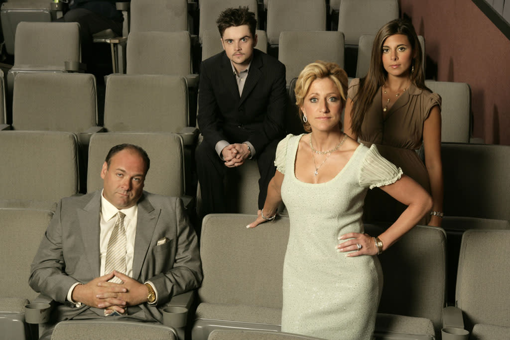 "James Gandolfini, Robert Iler, Edie Falco, and Jamie-Lynn Sigler in HBO's ""The Sopranos."""