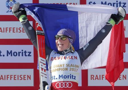 Alpine Skiing - FIS Alpine Skiing World Championships - Women's Giant Slalom - St. Moritz, Switzerland - 16/2/17 - Gold medalist Tessa Worley of France holds up a French flag during the flower ceremony.        REUTERS/Ruben Sprich