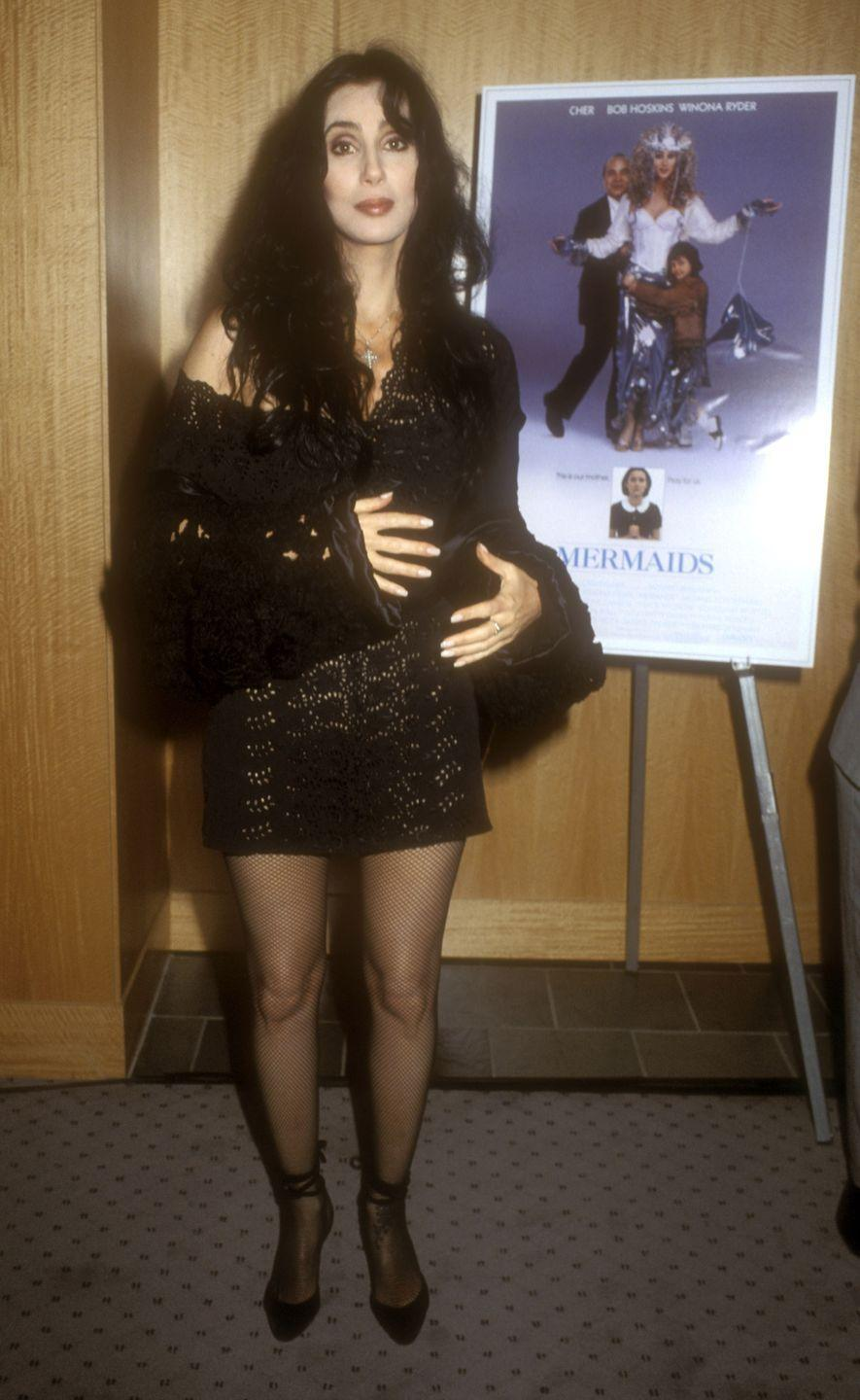 <p>In a black sheer dress and pumps at the premiere of <em>Mermaids</em>. </p>