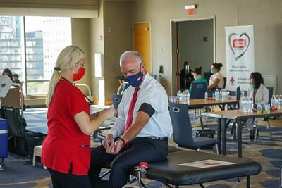 Suburban Propane President & CEO, Michael Stivala prepares to donate blood during the Seventh Annual Jersey City Police & Fire 9/11 Memorial Blood Drive.