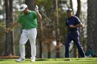 Phil Mickelson, right, watches as Louis Oosthuizen, of South Africa, reacts to his drive on the fourth tee during the third round of the Masters golf tournament Saturday, Nov. 14, 2020, in Augusta, Ga. (AP Photo/David J. Phillip)