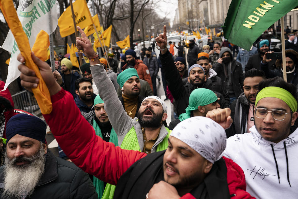 Protesters chant on Fifth Avenue outside the Consulate General of India, Tuesday, Jan. 26, 2021, in the Manhattan borough of New York. Republic Day marks the anniversary of the adoption of India's constitution on Jan. 26, 1950. (AP Photo/John Minchillo)
