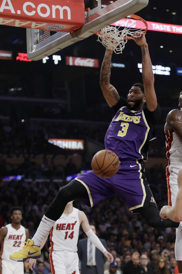 Los Angeles Lakers' Anthony Davis (3) dunks against the Miami Heat during the first half of an NBA basketball game Friday, Nov. 8, 2019, in Los Angeles. (AP Photo/Marcio Jose Sanchez)