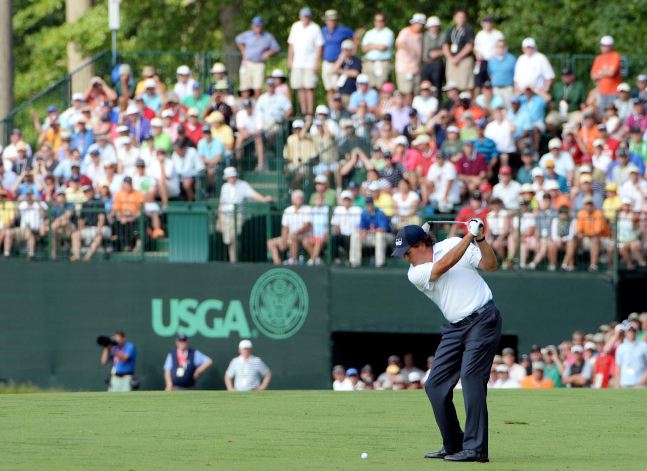 ARDMORE, PA - JUNE 15: Phil Mickelson of the United States hits his second shot on the eighth hole during Round Three of the 113th U.S. Open at Merion Golf Club on June 15, 2013 in Ardmore, Pennsylvania.  (Photo by Ross Kinnaird/Getty Images)
