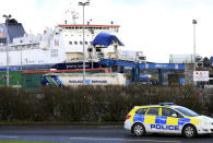 FILE - In this file photo dated Friday, Jan. 1, 2021, lorries disembark a ferry from Scotland, after arriving at the P&O ferry terminal in the port at Larne, Northern Ireland. Outlawed Loyalist paramilitary groups in Northern Ireland have written to Britain's prime minister Thursday March 4, 2021, saying they are temporarily withdrawing their support for the historic 1998 peace accord because of disruption caused by new post-Brexit trade rules. (AP Photo/Peter Morrison, FILE)