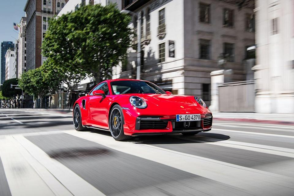 "<p>Launching another mighty salvo in the horsepower wars, the <a href=""https://www.caranddriver.com/porsche/911-turbo-turbo-s"" rel=""nofollow noopener"" target=""_blank"" data-ylk=""slk:2021 Porsche 911 Turbo and Turbo S"" class=""link rapid-noclick-resp"">2021 Porsche 911 Turbo and Turbo S</a> are poised to up the ante with <a href=""https://www.caranddriver.com/news/a29714274/2020-porsche-911-turbo-s-details/"" rel=""nofollow noopener"" target=""_blank"" data-ylk=""slk:up to 640 horsepower"" class=""link rapid-noclick-resp"">up to 640 horsepower</a>. High-output sports cars such as the 577-hp <a href=""https://www.caranddriver.com/mercedes-amg/gt-gt-s-gt-c-gt-r"" rel=""nofollow noopener"" target=""_blank"" data-ylk=""slk:Mercedes-AMG GT R"" class=""link rapid-noclick-resp"">Mercedes-AMG GT R</a>, the 602-hp <a href=""https://www.caranddriver.com/audi/r8"" rel=""nofollow noopener"" target=""_blank"" data-ylk=""slk:Audi R8"" class=""link rapid-noclick-resp"">Audi R8</a>, and the 631-hp <a href=""https://www.caranddriver.com/lamborghini/huracan"" rel=""nofollow noopener"" target=""_blank"" data-ylk=""slk:Lamborghini Huracán Evo"" class=""link rapid-noclick-resp"">Lamborghini Huracán Evo</a> are all rivals to both 911 Turbos, but none of them come with the same heritage and storied history. With coupe and cabriolet body styles, they offer similar standard and optional equipment as lesser 911 models but are powered by a more powerful twin-turbocharged 3.7-liter flat-six engine located—where else?—in the rear.</p><p><a class=""link rapid-noclick-resp"" href=""https://www.caranddriver.com/porsche/911-turbo-turbo-s"" rel=""nofollow noopener"" target=""_blank"" data-ylk=""slk:Review, Pricing, and Specs"">Review, Pricing, and Specs</a></p>"
