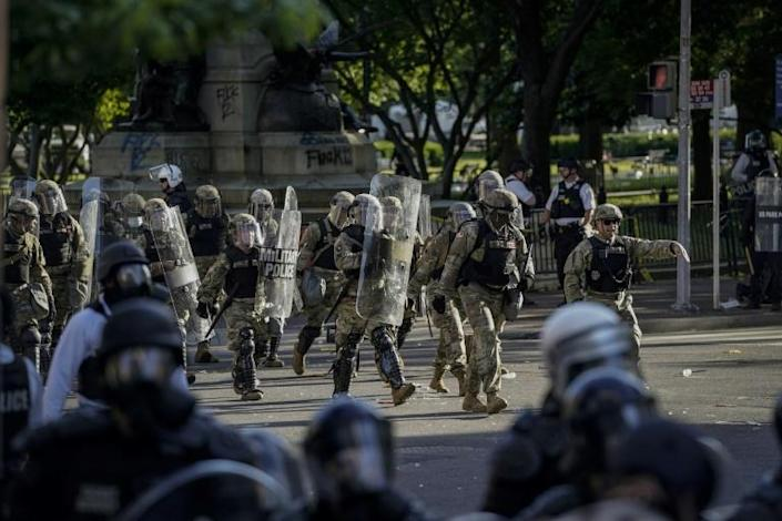 Law enforcement force peaceful protestors out in preparation for President Donald Trump and top advisors to take pictures at a church near the White House on June 1 (AFP Photo/Drew Angerer)