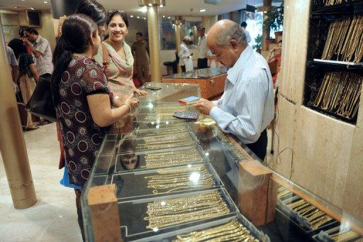 Indian women buy gold jewellery at a shop in New Delhi