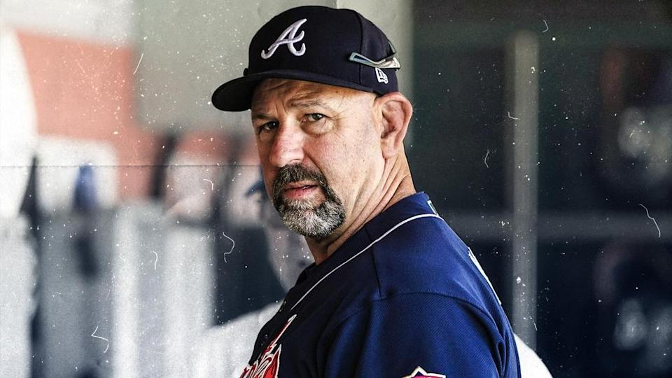 Walt Weiss treated image, wearing Braves uniform and cap, turning to side and looking into camera