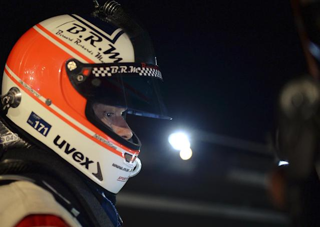 Porsche driver Emmanuel Collard, of France, waits in the pits during night practice for the American Le Mans Series' Petit Le Mans auto race at Road Atlanta, Thursday, Oct. 17, 2013, in Braselton, Ga. (AP Photo/Rainier Ehrhardt)