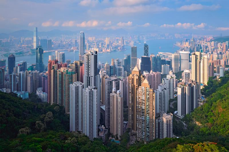 Hong Kong skyscrapers skyline cityscape view from Victoria Peak on sunset. (Photo: Getty Images)