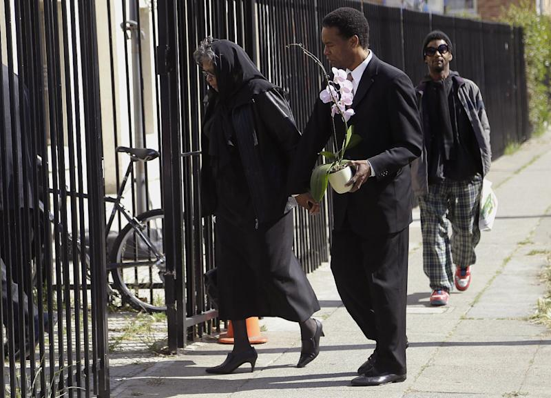 A man and woman arrive at a service for Malcolm Shabazz, the grandson of Malcolm X, at the Islamic Center of Northern California in Oakland, Calif., Friday, May 17, 2013. Authorities say Shabazz was beaten to death last week in a dispute over a $1,200 bar bill in Mexico City. The 28-year-old grandson of the slain civil rights leader had a troubled life, from setting a blaze in his grandmother's apartment that resulted in the death of Malcolm X's widow, Betty Shabazz, to stints in juvenile hall and prison. (AP Photo/Jeff Chiu)