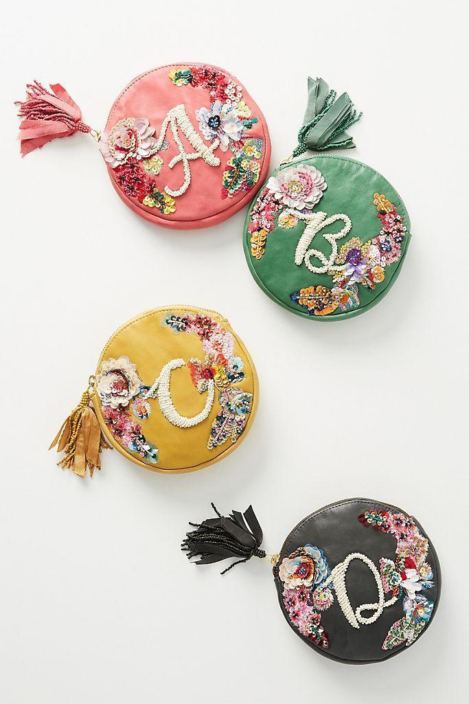 """<p><strong>Anthropologie</strong></p><p>anthropologie.com</p><p><strong>$42.00</strong></p><p><a href=""""https://go.redirectingat.com?id=74968X1596630&url=https%3A%2F%2Fwww.anthropologie.com%2Fshop%2Fembellished-leather-monogram-pouch&sref=https%3A%2F%2Fwww.countryliving.com%2Fshopping%2Fgifts%2Fg2077%2Fchristmas-presents%2F"""" rel=""""nofollow noopener"""" target=""""_blank"""" data-ylk=""""slk:Shop Now"""" class=""""link rapid-noclick-resp"""">Shop Now</a></p><p>For holding bits and bobs and odds and ends.</p>"""