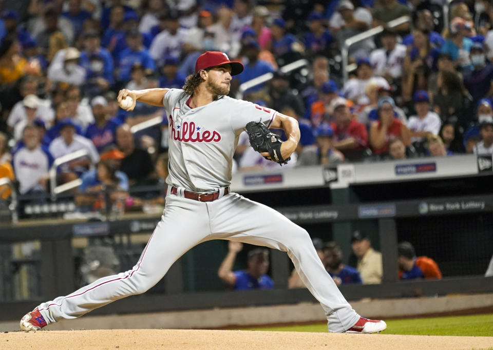 Philadelphia Phillies pitcher Aaron Nola delivers against the New York Mets during the first inning of a baseball game, Saturday, Sept. 18, 2021, in New York. (AP Photo/Mary Altaffer)