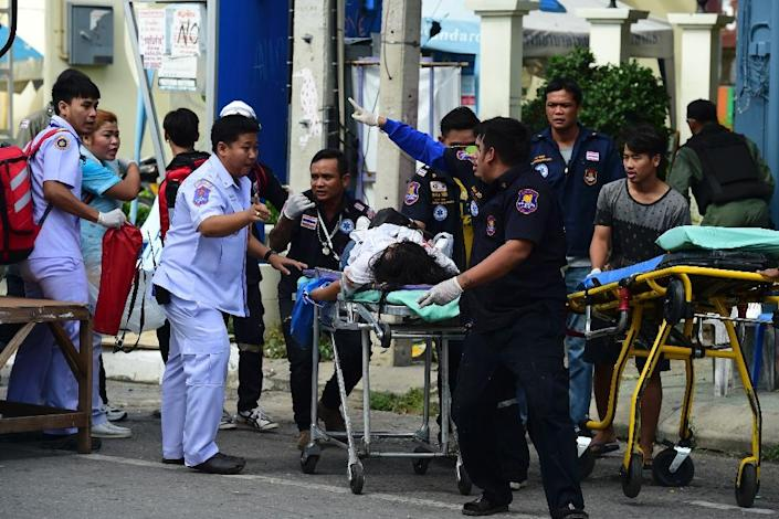 Rescue workers attend to an injured victim after a bomb exploded in Hua Hin (AFP Photo/Munir Uz Zaman)