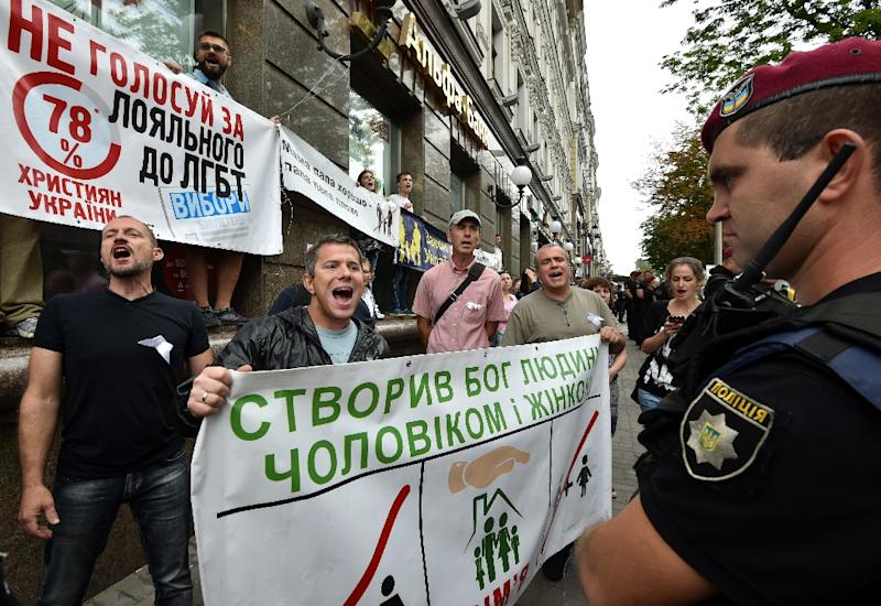 Far-right activists protest against a gay pride march in central Kiev amid a large police presence