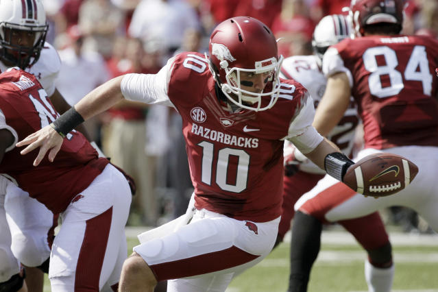 FILE - In this Oct. 12, 2013, file photo, Arkansas quarterback Brandon Allen (10) hands off during the second quarter of an NCAA college football game against South Carolina in Fayetteville, Ark. Allen is still looking for that signature game as the starting quarterback at Arkansas, especially after last week's 30-yard passing performance in a loss to South Carolina. (AP Photo/Danny Johnston, File)