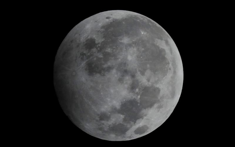 January's Wolf Moon pictured during the penumbral lunar eclipse - REX