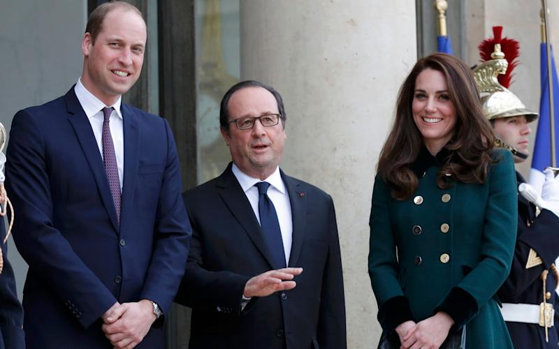 French President Francois Hollande greets the Duke and Duchess of Cambridge - Credit: PHILIPPE WOJAZER/Reuters