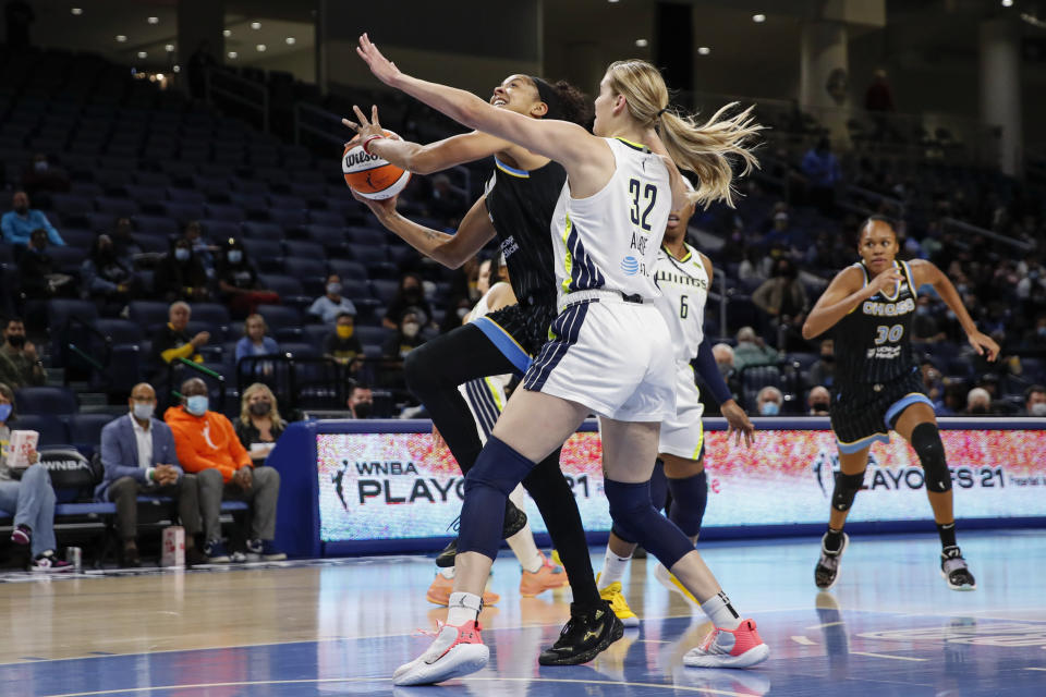 Chicago Sky center Candace Parker, left, goes to the basket against Dallas Wings center Bella Alarie (32) during the first half in the first round of the WNBA basketball playoffs, Thursday, Sept. 23, 2021, in Chicago. (AP Photo/Kamil Krzaczynski)