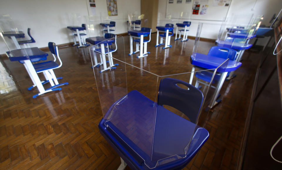 SAO PAULO, BRAZIL - OCTOBER 02: View of a classroom with protective shields on the tables and safety distance at Santa Maria school during the preparation of reopening schools amidst the coronavirus (COVID - 19) pandemic on October 2, 2020 in Sao Paulo, Brazil. (Photo by Miguel Schincariol/Getty Images)