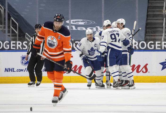 Toronto Maple Leafs celebrate a goal against the Edmonton Oilers during the second period of an NHL hockey game Wednesday, March 3, 2021, in Edmonton, Alberta. (Jason Franson/The Canadian Press via AP)
