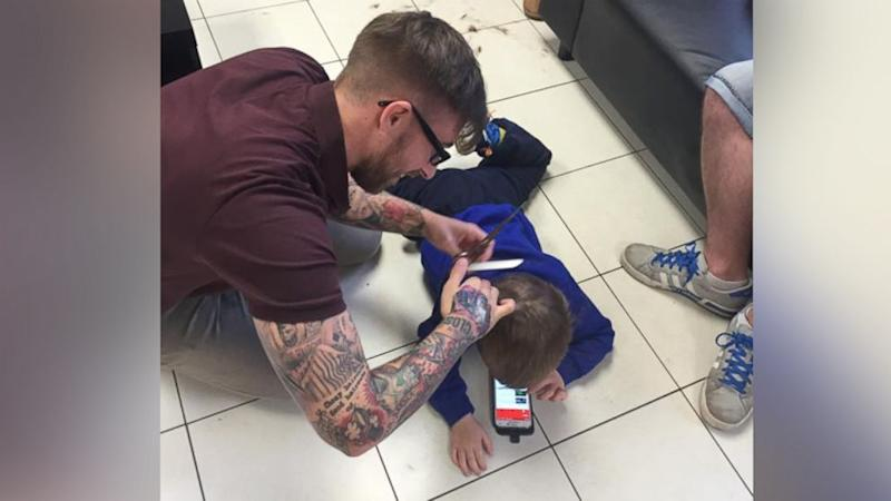 Why the Internet Loves This Photo of a Barber Giving Haircut to Little Boy