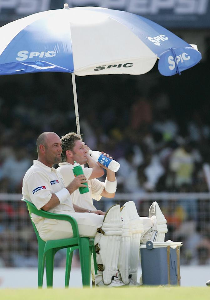 CHENNAI, INDIA - OCTOBER 17:  Michael Clarke and Darren Lehmann of Australia take shade during a drinks break during day four of the Second Test between India and Australia played at MA Chidambaram Stadium on October 17, 2004 in Chennai, India. (Photo by Hamish Blair/Getty Images)