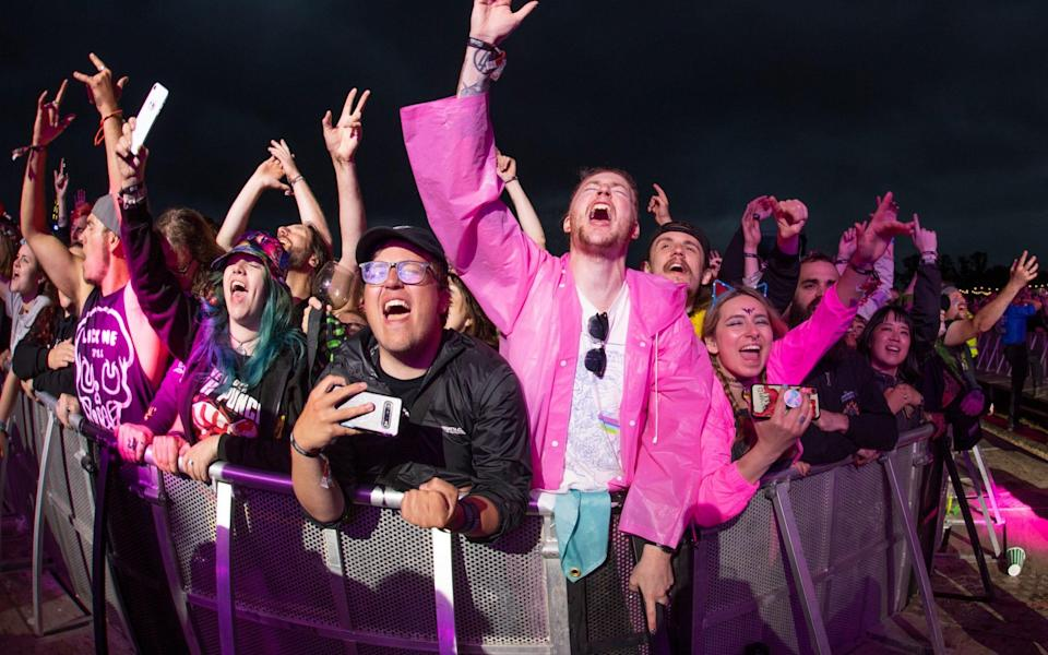 Festivalgoers react during the Enter Shikari performance on the main stage at the pilot for Download - Getty Images Europe