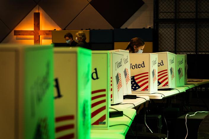 Voters fill in their ballots at a polling station set up inside the auditorium at Seacoast Church in Mount Pleasant, S.C., on Tuesday, Nov. 3, 2020. (Cameron Pollack/The New York Times)