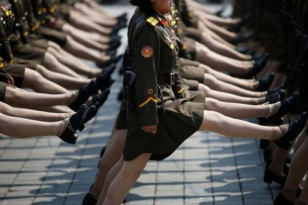 North Korean soldiers march during a military parade marking the 105th birth anniversary of the country's founding father Kim Il Sung in Pyongyang, North Korea.    REUTERS/Damir Sagolj