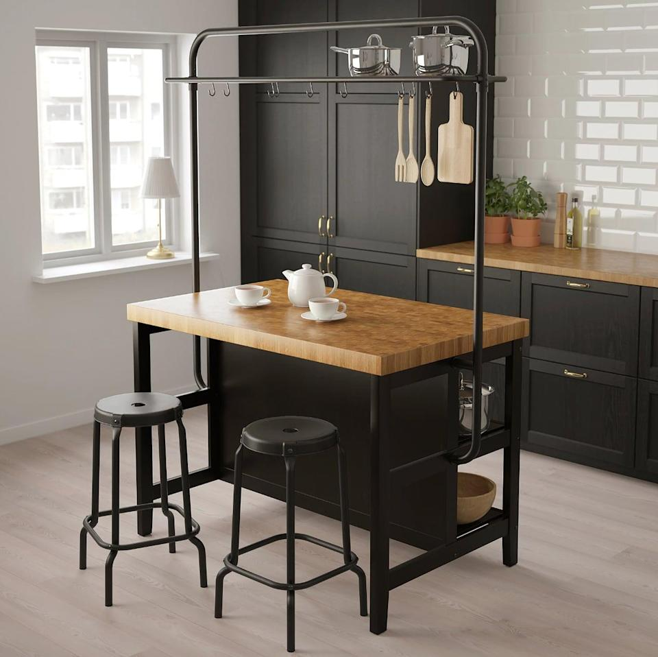 "<p>The compact <a href=""https://www.popsugar.com/buy/Vadholma%20Kitchen%20Island%20With%20Rack-447006?p_name=Vadholma%20Kitchen%20Island%20With%20Rack&retailer=ikea.com&price=548&evar1=casa%3Aus&evar9=46151613&evar98=https%3A%2F%2Fwww.popsugar.com%2Fhome%2Fphoto-gallery%2F46151613%2Fimage%2F46152195%2FVadholma-Kitchen-Island-Rack&list1=shopping%2Cikea%2Corganization%2Ckitchens%2Chome%20shopping&prop13=api&pdata=1"" rel=""nofollow noopener"" target=""_blank"" data-ylk=""slk:Vadholma Kitchen Island With Rack"" class=""link rapid-noclick-resp"">Vadholma Kitchen Island With Rack</a> ($548) is a freestanding island complete with a rack that lends room for storing cooking essentials on top, as well as hooks to hang other essentials. Not to mention, the butcher block gives you a robust and easy-to-clean workspace.</p>"