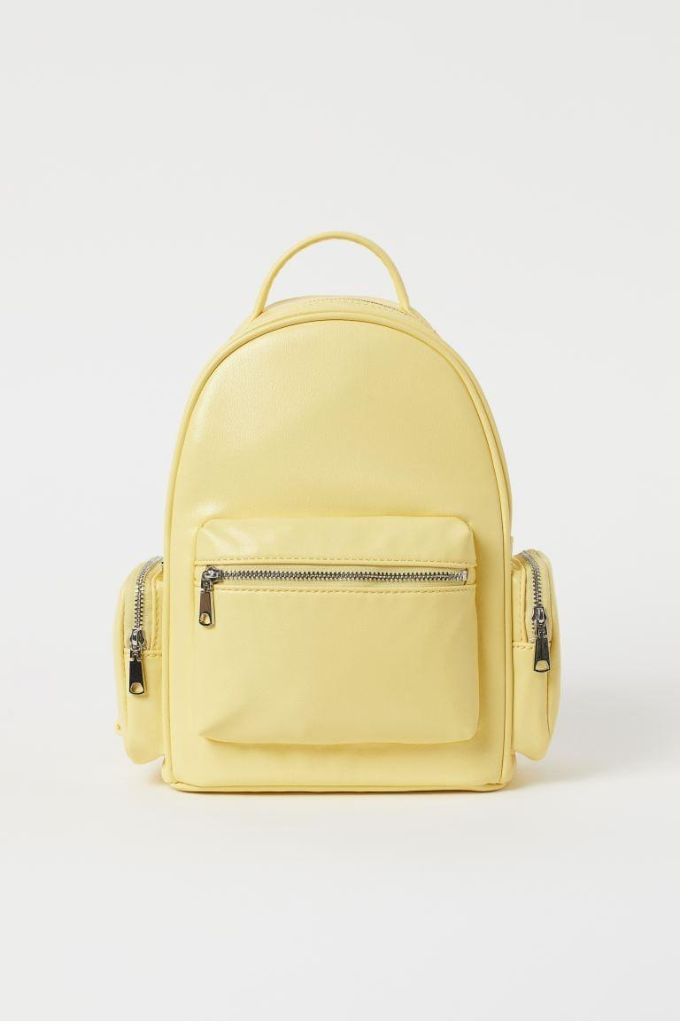 <p>Rock this <span>To All the Boys I've Loved Before x H&amp;M Small Yellow Backpack</span> ($30) that can carry your necessities from your extra scrunchies to face masks.</p>