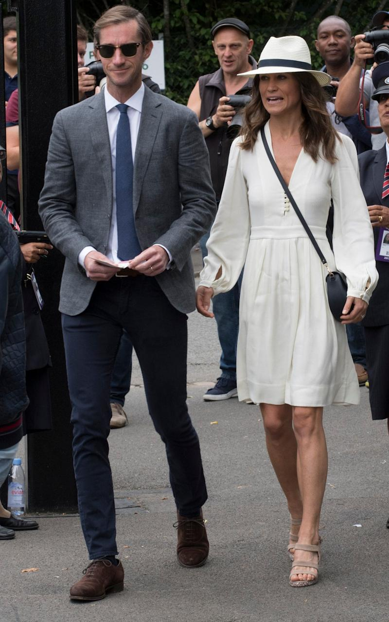 Pippa Middleton wearing a classic all-white Wimbledon look earlier this week - Credit: Heathcliff O'Malley