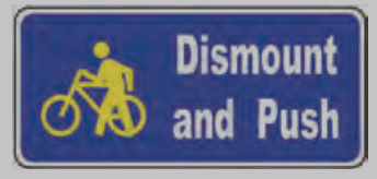 "A sign that says ""Dismount and Push""."