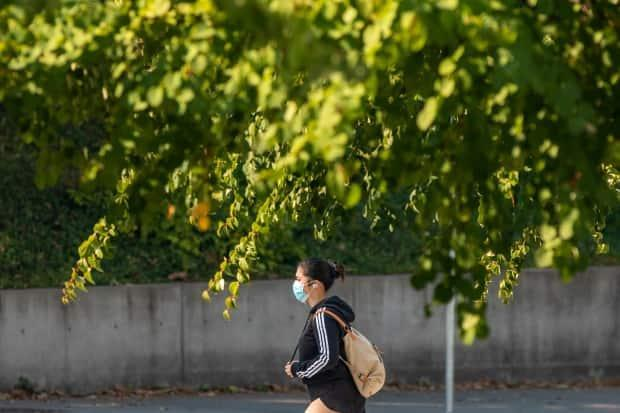 A student is pictured in Vancouver last September. The province's vaccine card' system is due to come into effect on Sept. 13. (Ben Nelms/CBC - image credit)