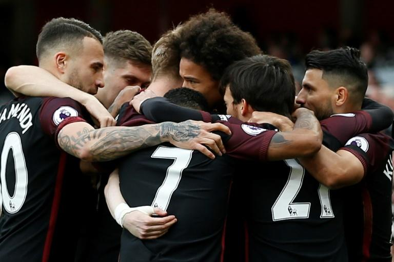 Teammates congratulate Manchester City's Leroy Sane (C) after he sored the opening goal during their English Premier League match against Arsenal, at The Emirates Stadium in London, on April 2, 2017