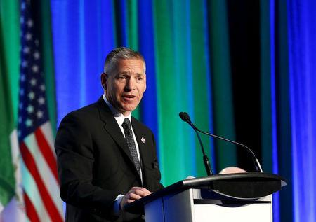 FILE PHOTO --  President and CEO Girling of TransCanada addresses shareholders during the company's annual general meeting in Calgary