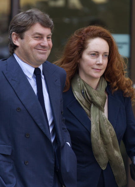 Former News International executive Rebekah Brooks, right, along with her husband Charlie Brooks leave Westminster Magistrates Court following an appearance on charges of perverting the course of justice, London, Wednesday, June 13, 2012. (AP Photo/Alastair Grant)