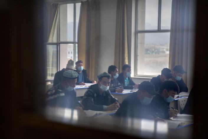 Uyghurs and other students attend a class at the Xinjiang Islamic Institute, as seen during a government organized visit for foreign journalists, in Urumqi in western China's Xinjiang Uyghur Autonomous Region on April 22, 2021. Under the weight of official policies, the future of Islam appears precarious in Xinjiang, a remote region facing Central Asia in China's northwest corner. Outside observers say scores of mosques have been demolished, which Beijing denies, and locals say the number of worshippers is on the decline. (AP Photo/Mark Schiefelbein)