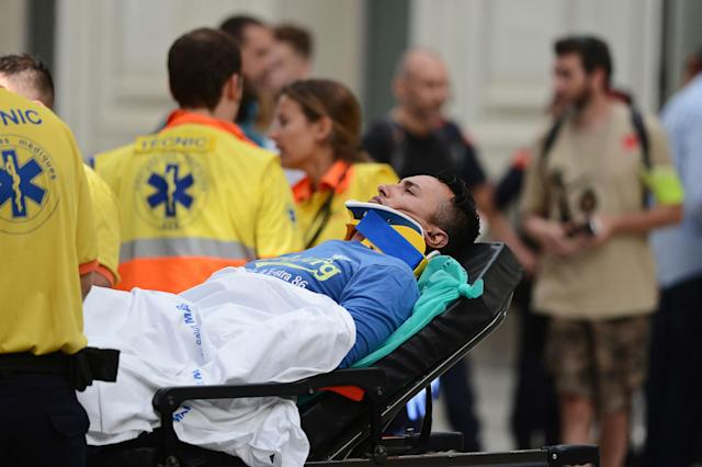 <p>An injured passenger is taken away on a stretcher from a train station in Barcelona, Spain, Friday, July 28, 2017. (Photo: Adrian Quiroga/AP) </p>