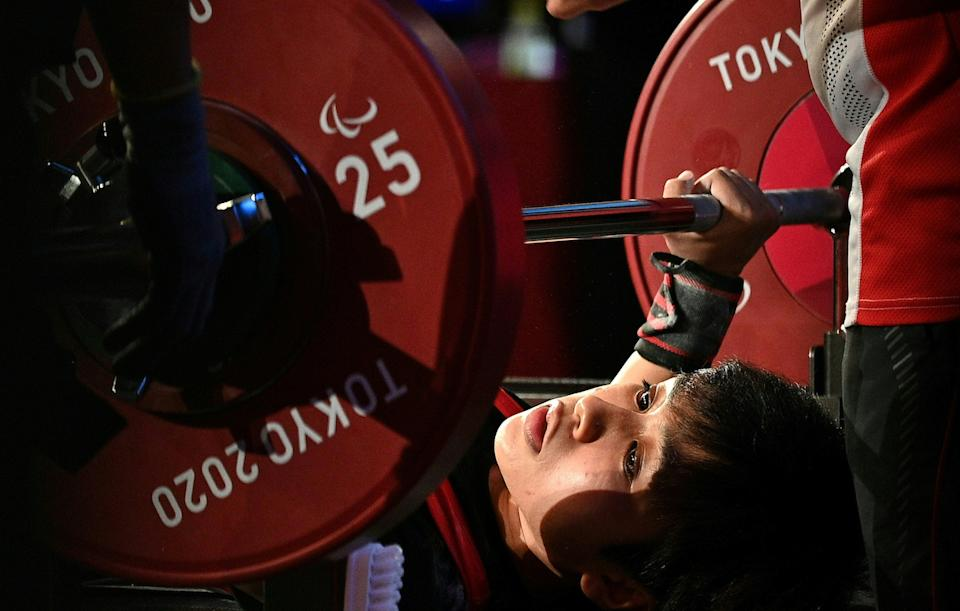 Singapore powerlifter Nur'Aini Mohamad Yasli competes in the women's under-45kg division at the 2020 Tokyo Paralympics. (PHOTO: Sport Singapore)