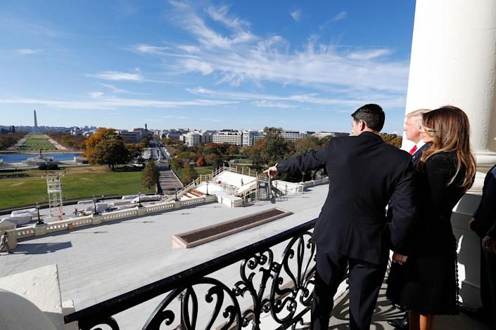 <p>House Speaker Paul Ryan of Wisconsin, left, shows President-elect Donald Trump and his wife, Melania, the view of the inaugural stand of Pennsylvania Avenue from the speaker's balcony on Capitol Hill in Washington, Nov. 10, 2016. (AP Photo/Alex Brandon) </p>