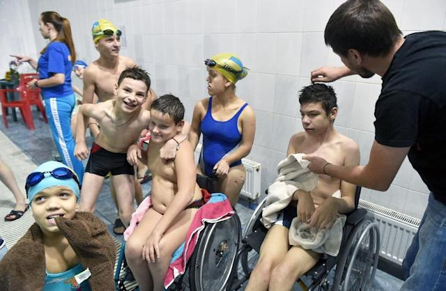 Disabled children rest after a training session in a swimming pool in Kiev (AFP Photo/Sergei Supinsky)